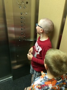 Riding an elevator to 2nd floor of Engineering. Where there is a great break room with snacks.